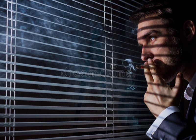 Business man smokes stock image