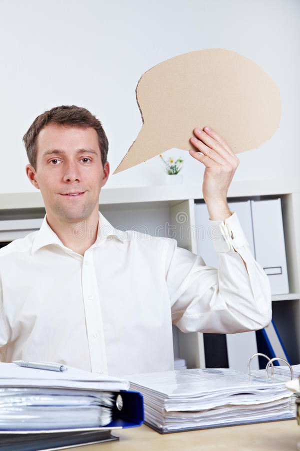 Business man with speech bubble stock images