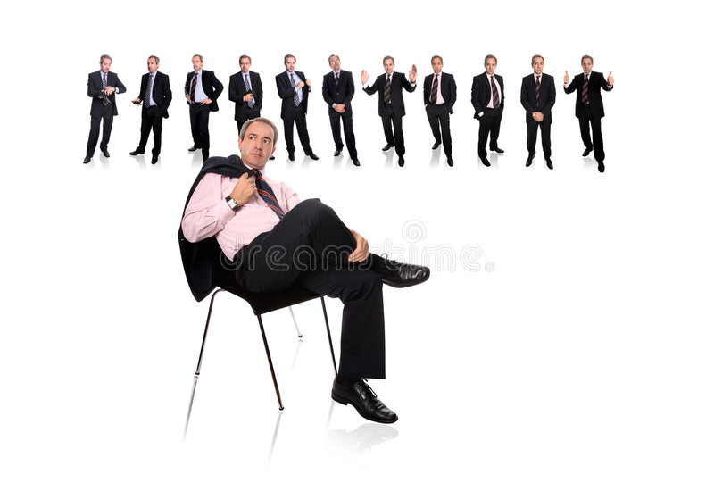 Business man and staff behind. Isolated on white royalty free stock photography