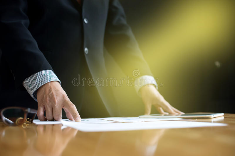 business man stand at the head of the table royalty free stock photos