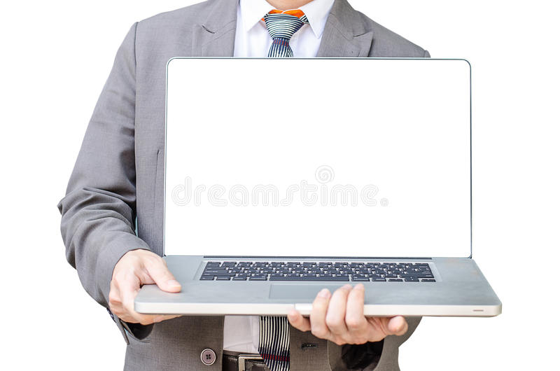 Business man stand with laptop computer facing the camera and s. Howing you something on laptop in white background stock images