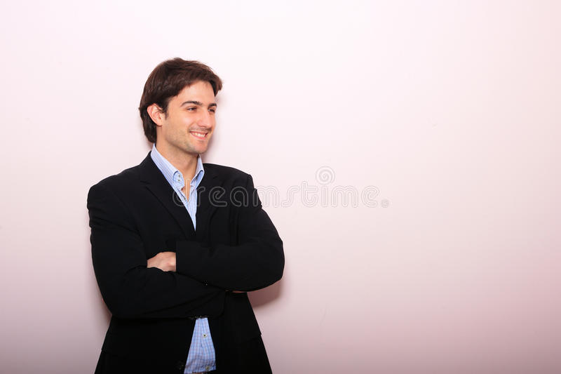 Business man standing with arms folded royalty free stock image
