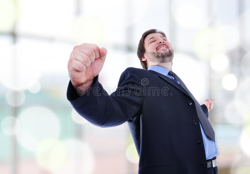 Business man standing with fists clenched