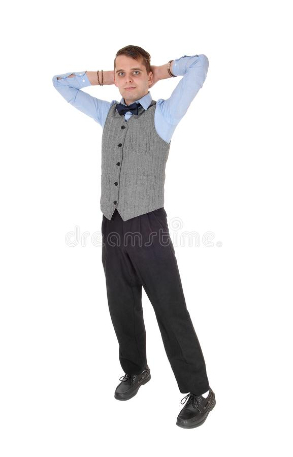 Business man standing with his hands behind his head stock images