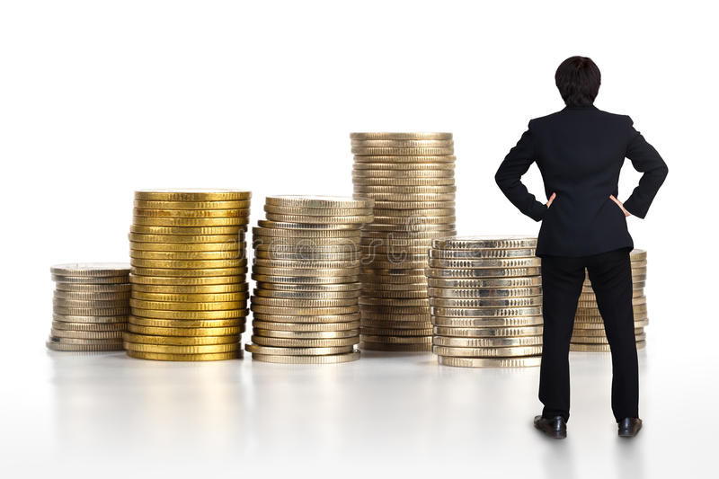 Business man standing with stack of coins. Isolated over white royalty free stock images
