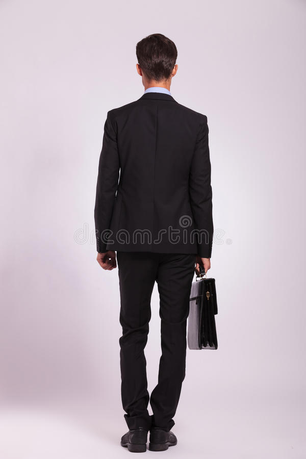 Business man stands with briefcase stock image
