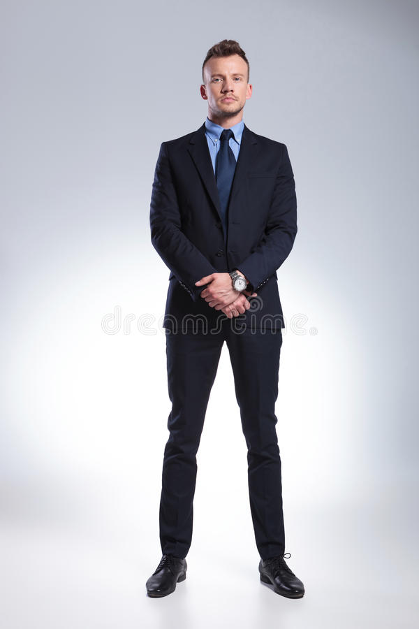 Business man stands with hands together royalty free stock images