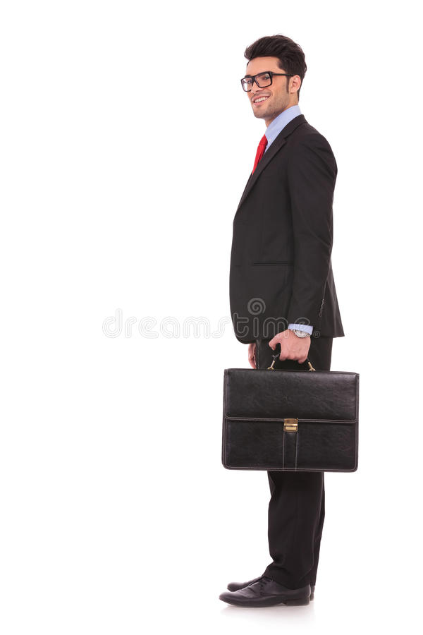 Business man stands and looks at you royalty free stock image