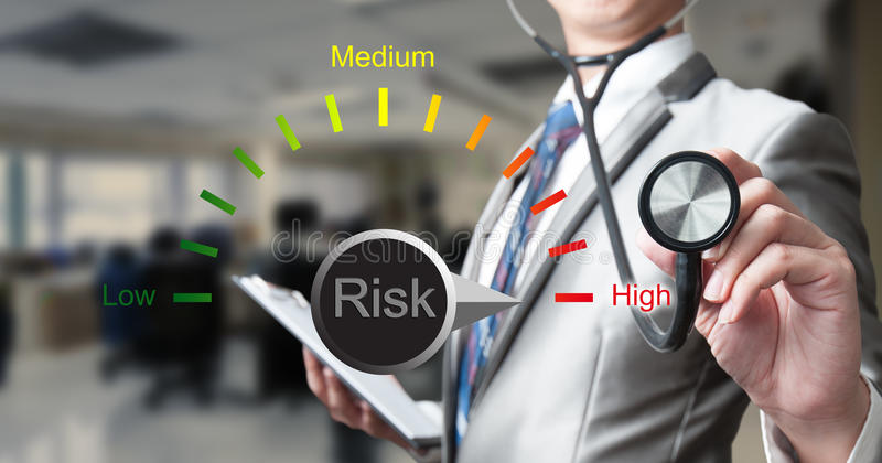 Business man with stethoscope examining risk. Business concept stock images