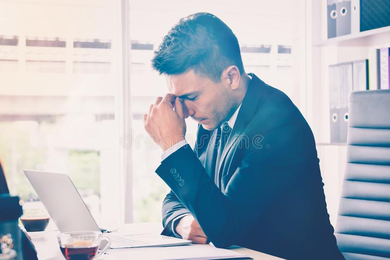 Business man stress or tension in office with burnout syndrome at desk work related Stress and Burnout royalty free stock photos