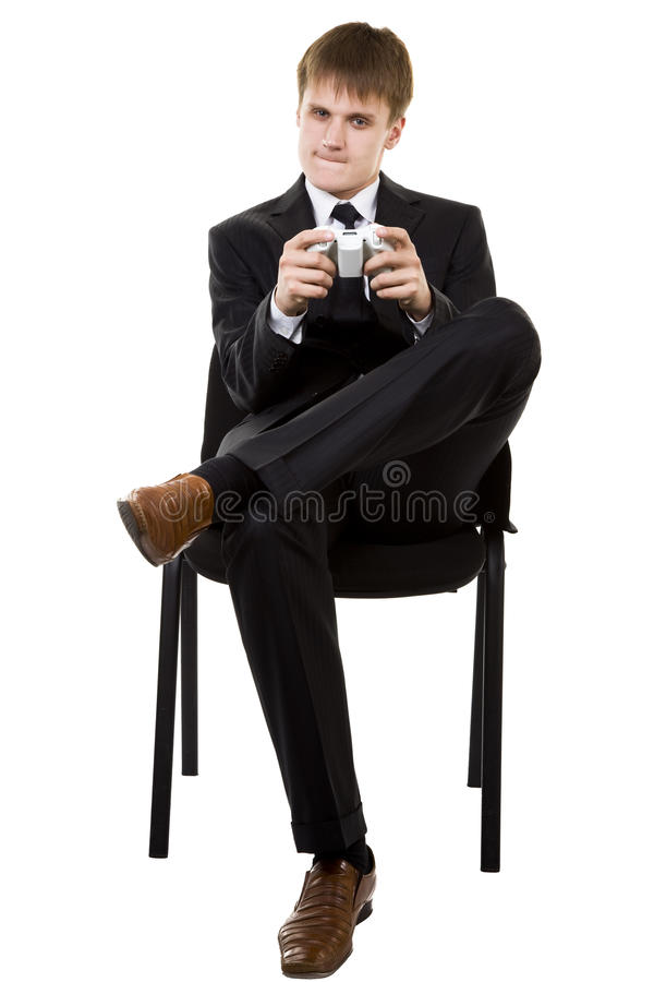 Business Man In Suit Playing Console Games Stock Photography