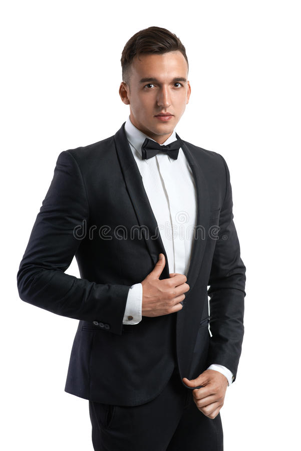 Business man in a suit straightens his jacket. Handsome business man in a suit straightens his jacket royalty free stock image
