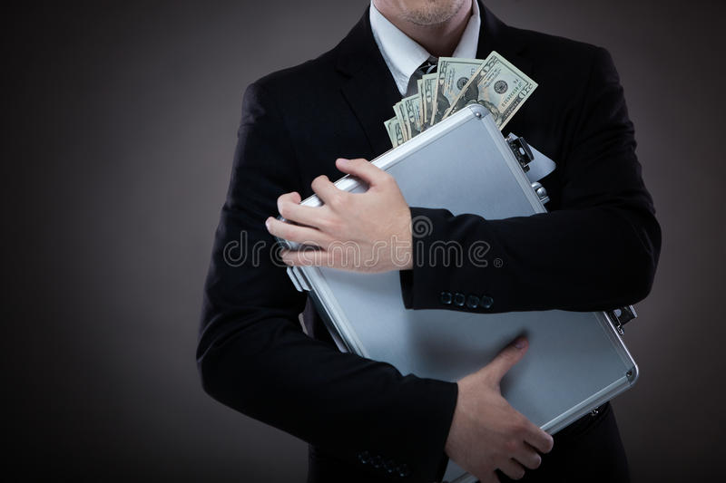 Business man with suitcase full of money stock photos