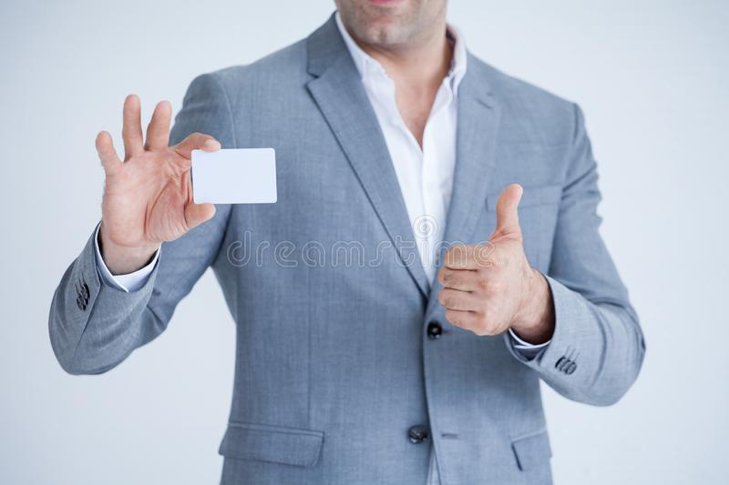 business man in Suits show thumb up and holding blank white credit card mockup isolated on white background with clipping path of stock photo