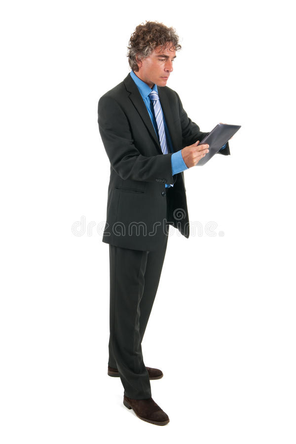 Download Business Man With Tablet In Studio Stock Photo - Image: 27191940