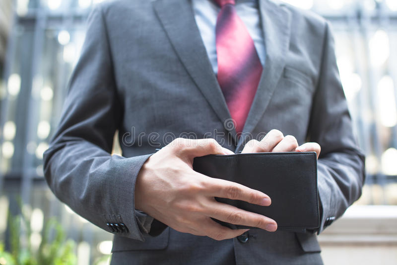 Business man taking bills out of wallet royalty free stock images