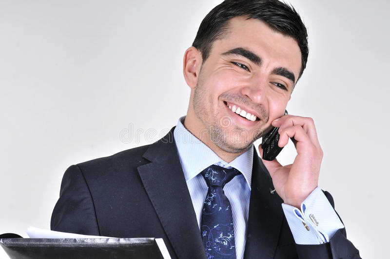 Business man talking on mobile phone royalty free stock images