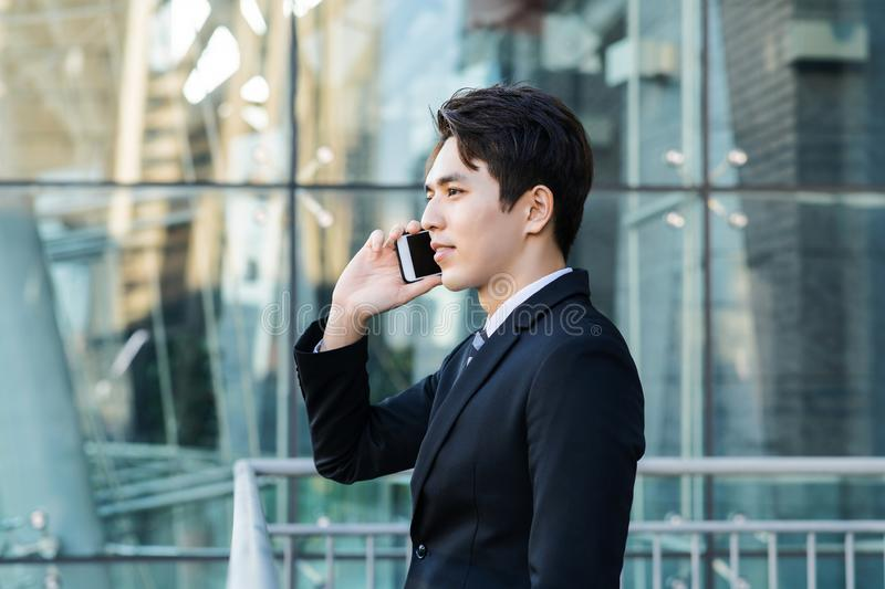 Business man talking on the phone with city building background royalty free stock photos