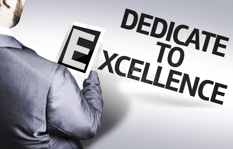 Business man with the text Dedicate to Excellence in a concept image stock image