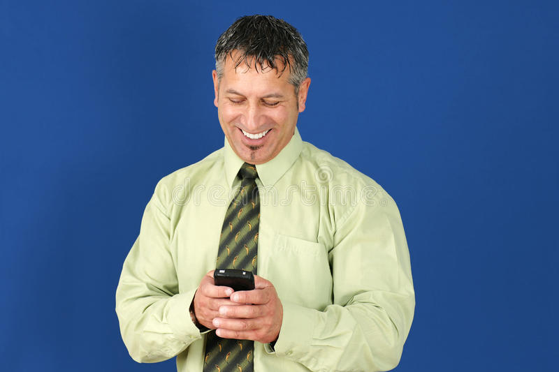 Business Man Texting On Cell Phone Royalty Free Stock Photography