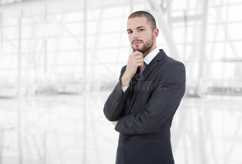 Business man thinking. Pensive business man portrait at the office stock photo