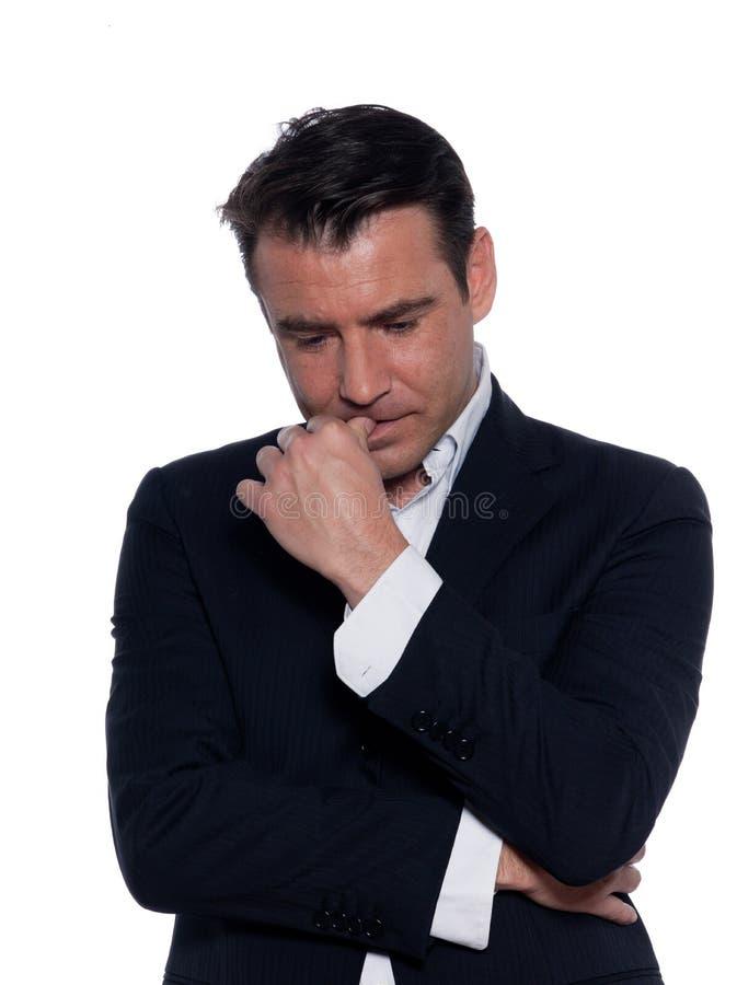 Business man thinking pensive portrait. Studio portrait on white background of a business man thiking pensive portrait royalty free stock photos