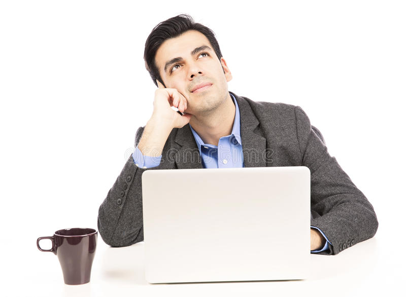Business man thinking. Young Hispanic business man using laptop isolated on withe background royalty free stock images
