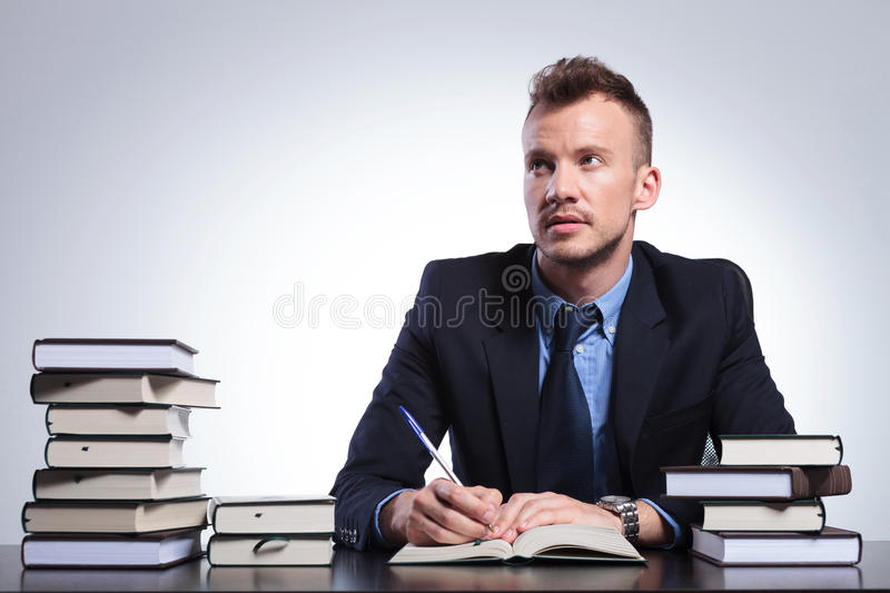 Business man thinks what to write royalty free stock photos