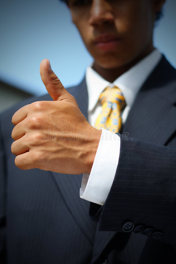 Business man thumbs up. Business man dressed in suit showing a thumbs up. Concept: Good job, well done stock image