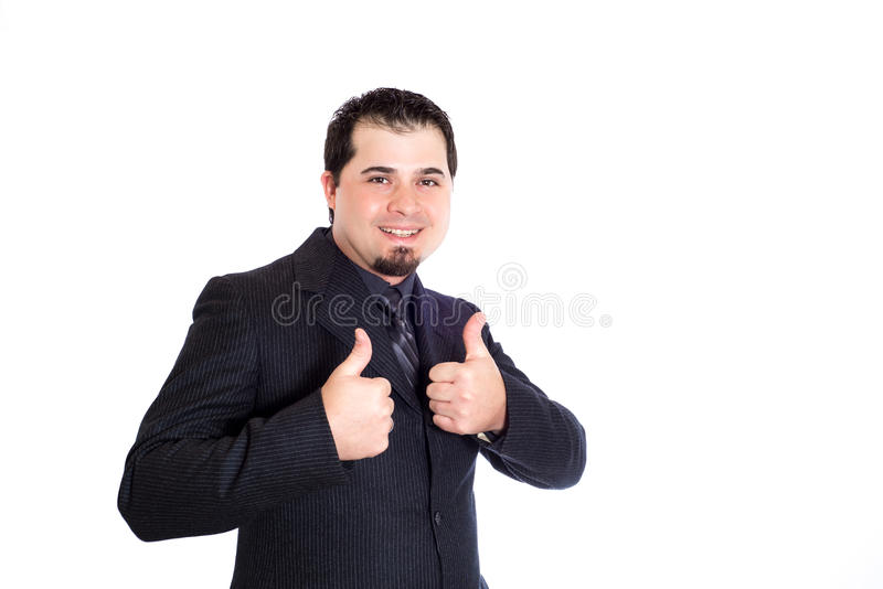 Business man thumbs up. A businessman giving both thumbs up. White background stock photos