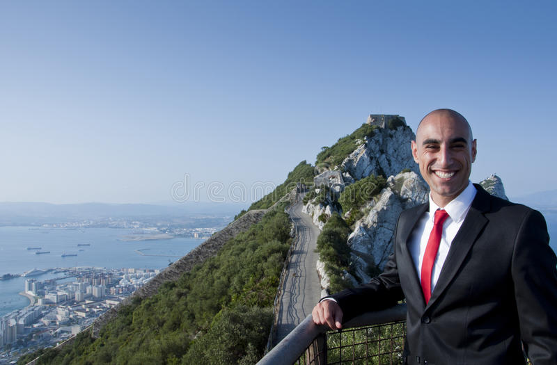 A business man on top of the world stock photos