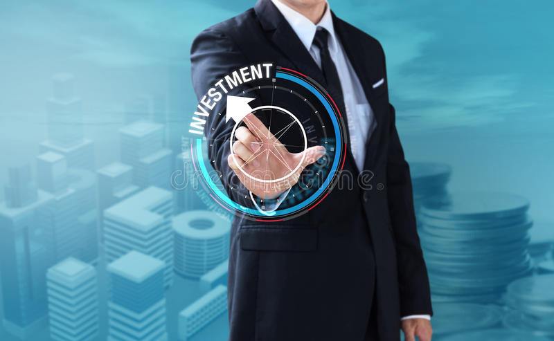 Business man touch rotate compass to investment. Management concept royalty free stock photography