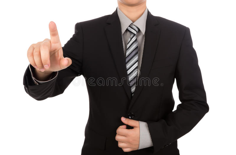 Business man touching an imaginary screen against. White background royalty free stock photography