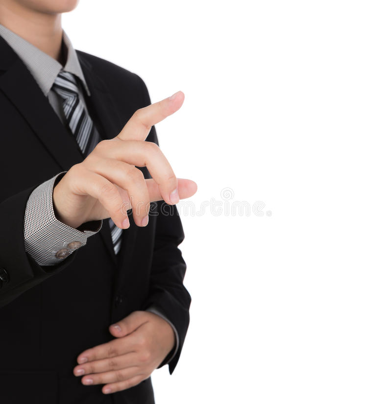 Business man touching an imaginary screen against. White background stock photo