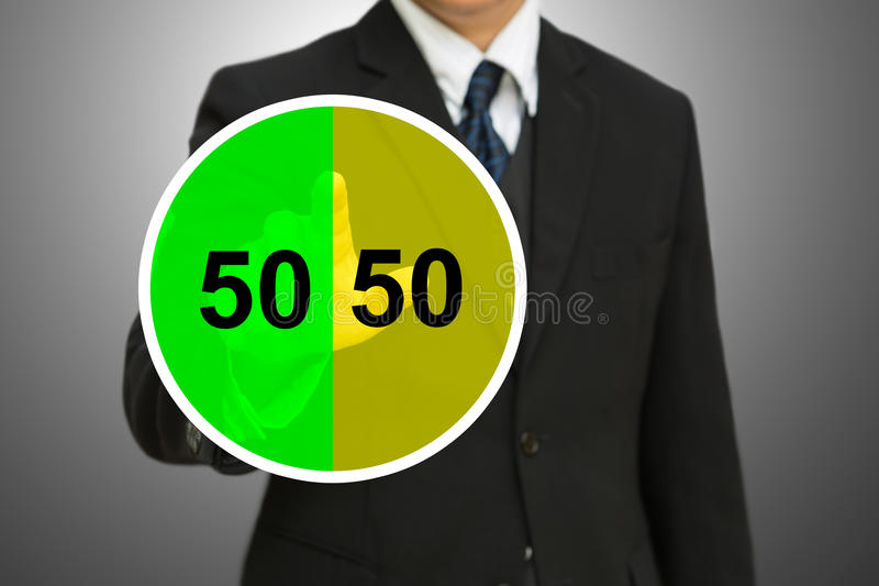 Business man touching on Pie chart with fifty-fift