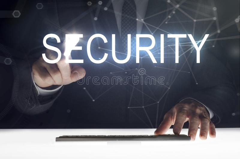 Business man touching screen with `Security` writing royalty free stock photos