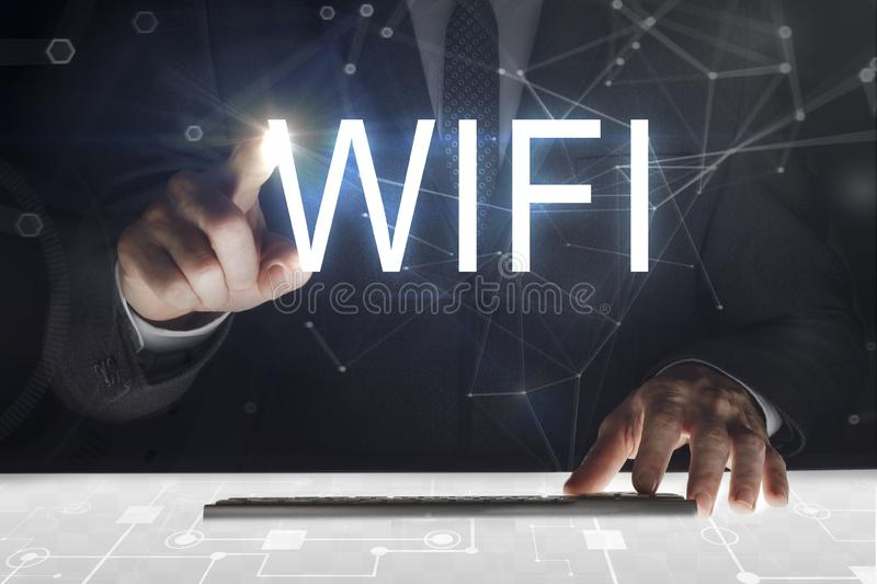 Business man touching screen with `Wifi` writing stock images