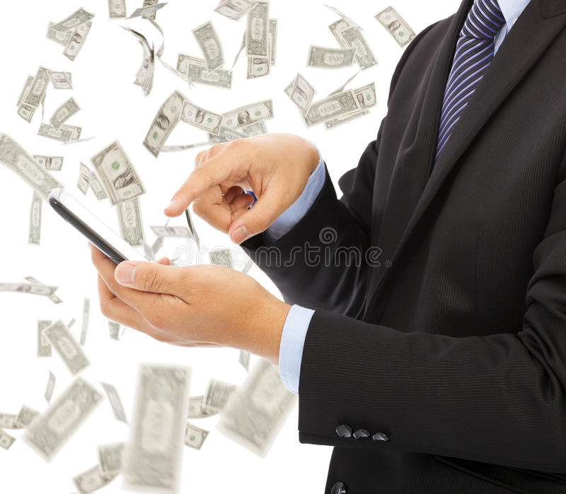 Business man touching smart phone with money rain background stock photography