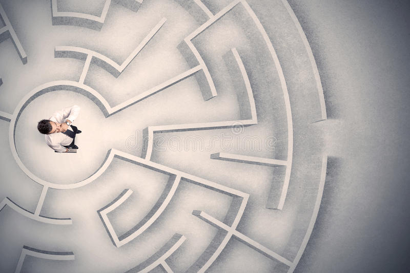 Business man trapped in a circular maze. Confused business man trapped in a circular maze stock photography