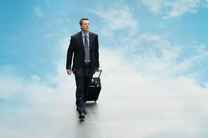 Business man travel the sky background clouding computing concept. Business man travel on the sky background clouding computing concept stock image