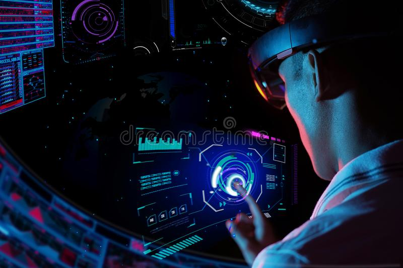 Business man try vr glasses hololens in the dark room | Young asian boy experience ar with glow earth globe on hand | Future royalty free stock photography