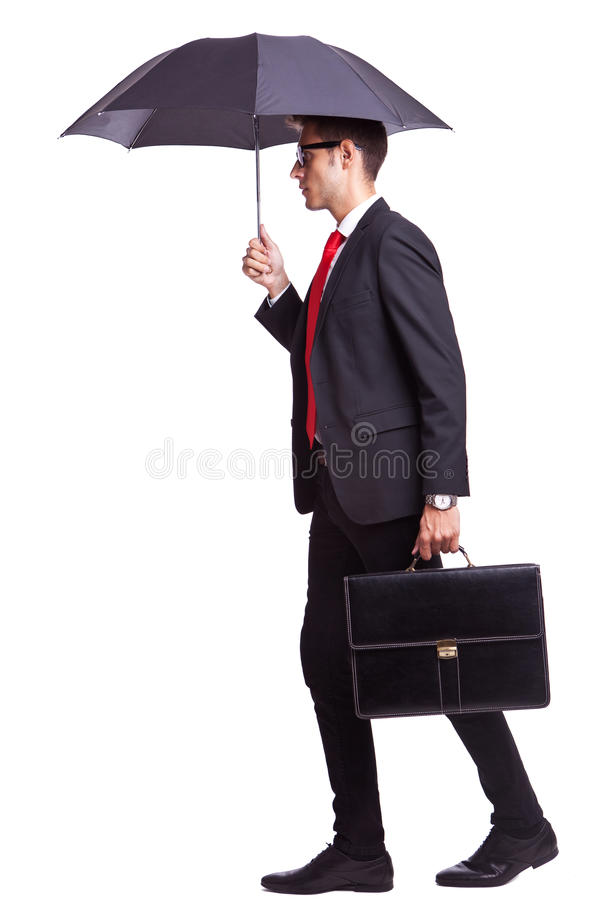 Business man with umbrella and briefcase stock photo