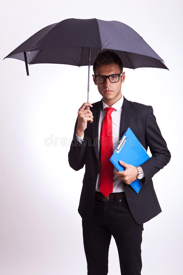 Download Business Man With Umbrella And Notepad Stock Image - Image: 26587313