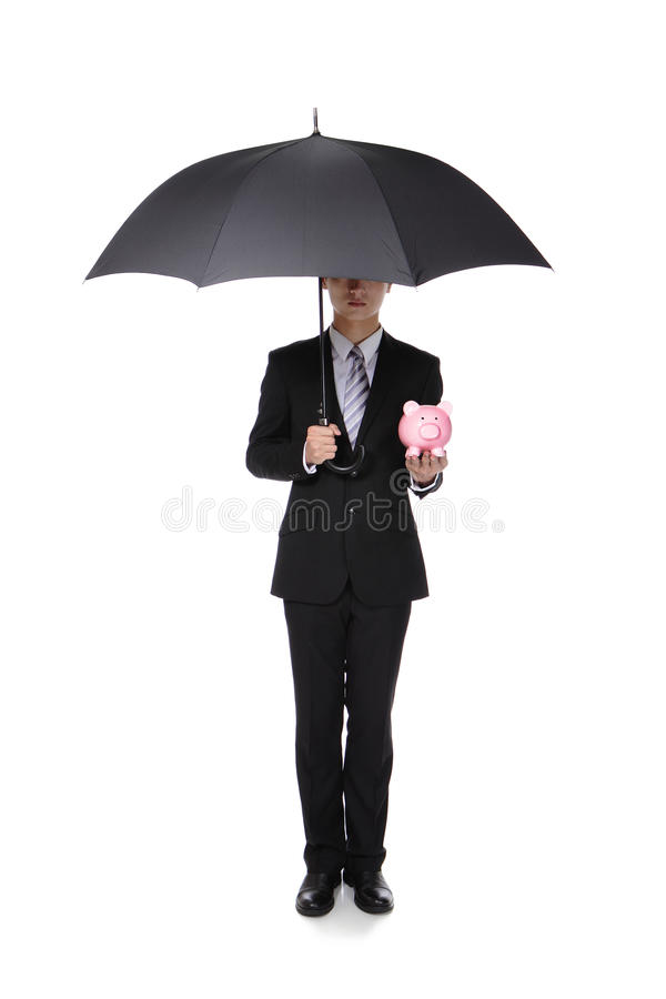 Business Man with an umbrella and piggy bank stock images
