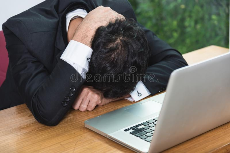Business man unhappy head down on laptop computer royalty free stock photo