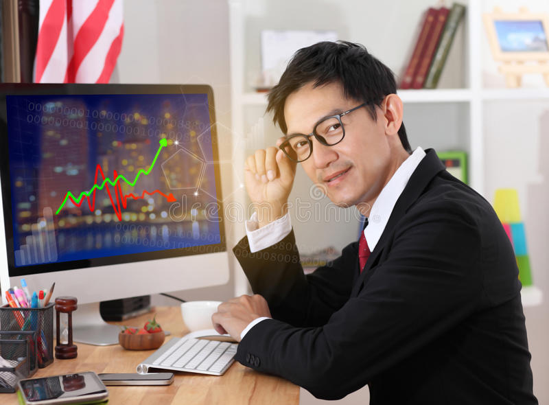 Business man use computer in office.Business man wearing glasses. And smiling.business man working on computer royalty free stock photo