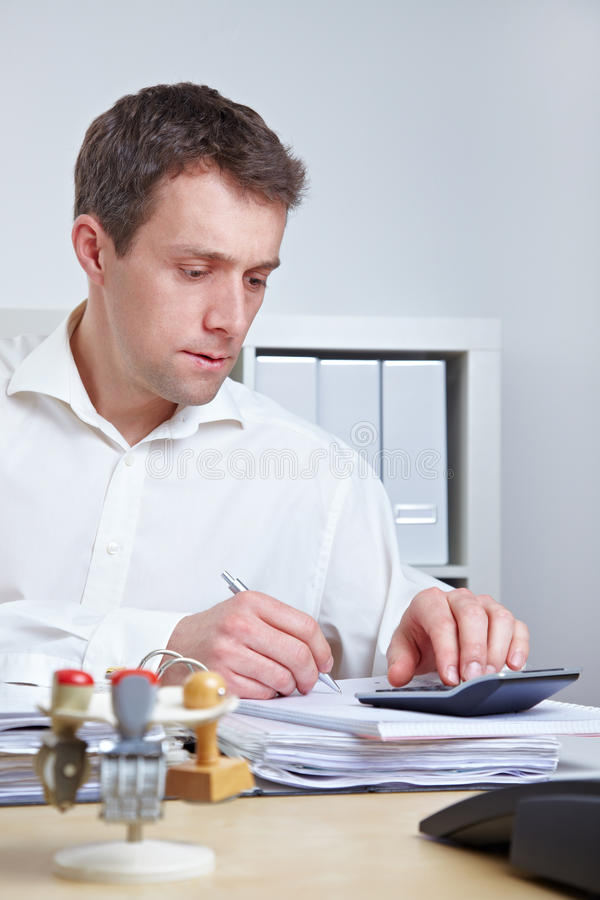 Download Business Man Using Calculator Stock Images - Image: 25470044