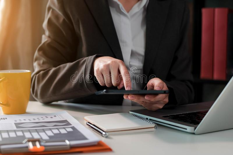 Business man using digital tablet analyzes business data in office. stock images