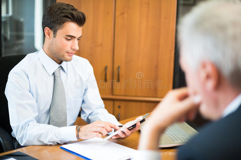 Business man using his tablet stock images