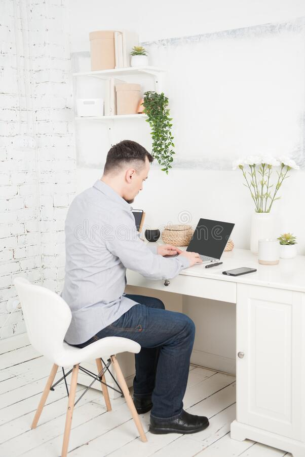 Business man using laptop at home. Freelance or distance study concept stock photo